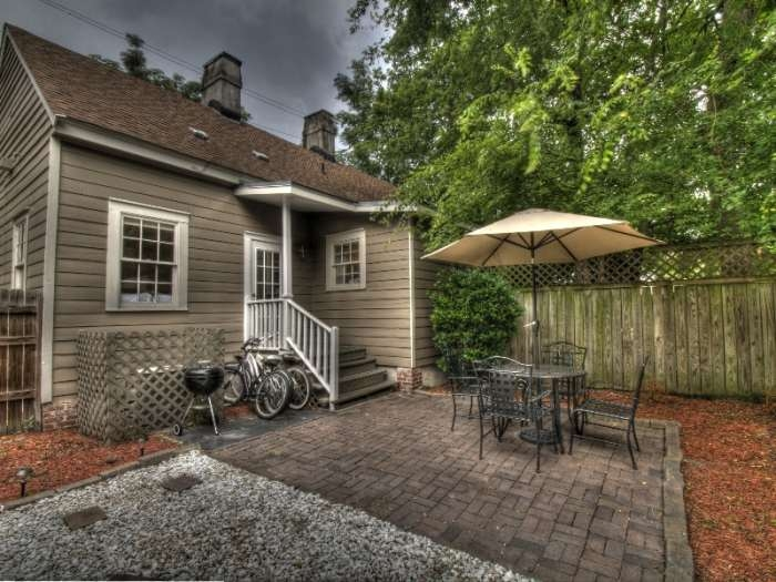 Kick back and relax in your private courtyard complete with  a weber grill and patio furniture and bikes